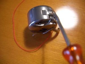 scatoletta con bobina particolare, vite regola tensione